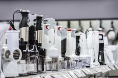 Row of variety blenders in retail store stock images