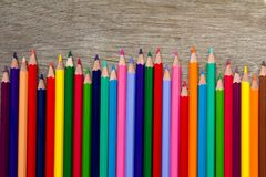 Row of various color pencil on wood background. Row of various color pencil on wooden background Royalty Free Stock Images
