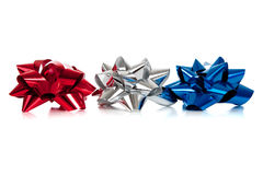Row of various colored christmas bows on white Stock Images