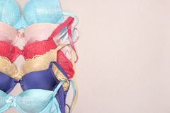 Row of various colored lace push-up bras with copy space. Row of lace push-up bras. Various colored brassieres. Fashion shopping background with copy space Royalty Free Stock Image