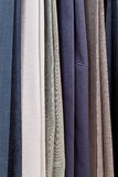 Row of various woolen pants in tailoring atelier Stock Photography