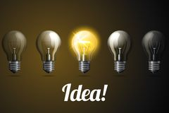 Row of vector realistic light bulbs, with one Royalty Free Stock Image