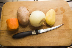 Row of vegetables and knife Royalty Free Stock Photo