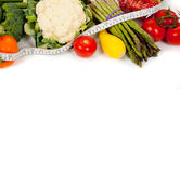 Row of vegetables with a tape on white Stock Photo
