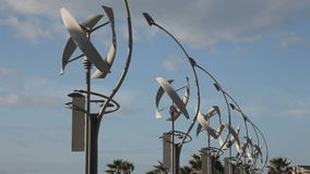 Row of vertical axis wind turbines stock video footage