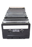Row of vintage audio tapes over white background Stock Photo