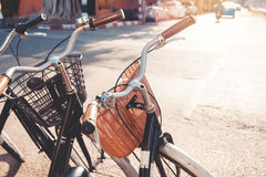 Row of a vintage bicycle for rent in the city street Stock Photography