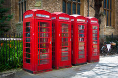 Row of vintage british red telephone boxes Royalty Free Stock Images