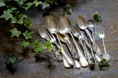 Row of vintage fork and spoons on old wooden Stock Image