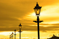 Row of vintage lamps at sunset Royalty Free Stock Photo