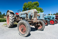Row vintage tractors royalty free stock photography
