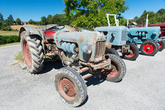 Row vintage tractors stock images