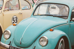 Row of vintage Volkswagen Beetles from the seventies. DEN BOSCH, THE NETHERLANDS - JANUARY 8, 2017: Row of vintage Volkswagen Beetles from the seventies in Den Stock Images