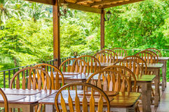 Row of vintage wooden tables and chairs Stock Images
