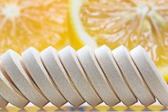 Row of Vitamin c tablets and fresh lemon stock photography