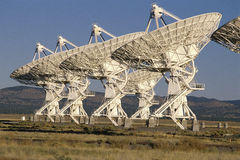 Row of VLA Very Large Array radio telescope dishes Stock Image