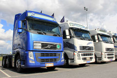 Row of Volvo Trucks. LIETO, FINLAND - AUGUST 31: Row of Volvo trucks on August 31, 2013 in Lieto, Finland. According to Volvo Group, one third of all goods royalty free stock photo