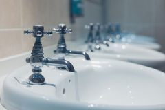 Row of wash basins in a bathroom Royalty Free Stock Photography