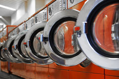 Row of washing machines in laundromat Royalty Free Stock Images