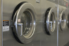 Washday Washing Machiine Row. Row of washing machines at a local laundromat Stock Photography