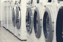 Washing mashines in appliance store royalty free stock photos