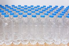 Row of water bottles. Bottles with blue caps For drinking water royalty free stock photo