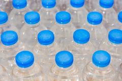 Row of water bottles. Bottles with blue caps For drinking water royalty free stock images