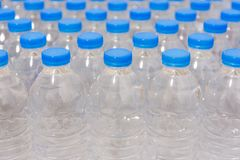 Row of water bottles. Bottles with blue caps For drinking water stock photography
