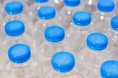 Row of water bottles. Bottles with blue caps For drinking water royalty free stock photography