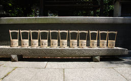 Row of Water Buckets Outside Shrine Royalty Free Stock Photos