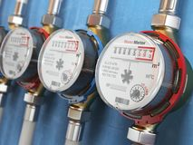 Row of water meters of cold and hot water on the wall background Royalty Free Stock Photo