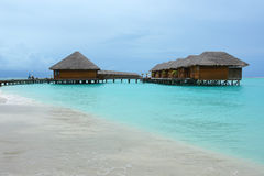 Row of water villas and jetty Royalty Free Stock Photos