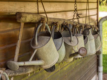 Row of watering cans Stock Photo