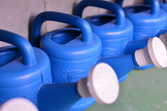 Row of watering cans Stock Image
