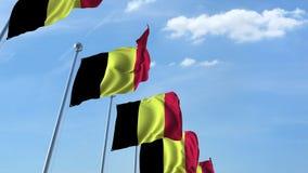 Row of waving flags of Belgium agaist blue sky, 3D rendering Royalty Free Stock Images