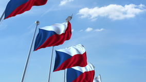 Row of waving flags of the Czech Republic agaist blue sky, 3D rendering Royalty Free Stock Photos