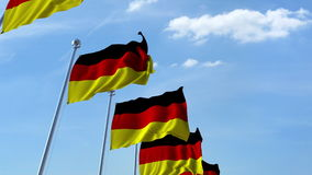 Row of waving flags of Germany agaist blue sky, 3D rendering Stock Images
