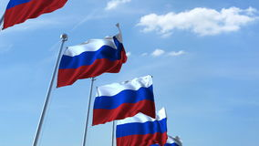 Row of waving flags of Russia agaist blue sky, 3D rendering Royalty Free Stock Photo