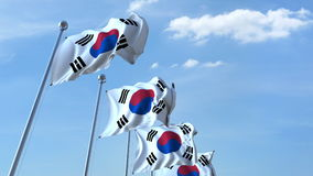 Row of waving flags of South Korea agaist blue sky, 3D rendering Royalty Free Stock Image