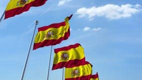 Row of waving flags of Spain agaist blue sky, 3D rendering Royalty Free Stock Photo