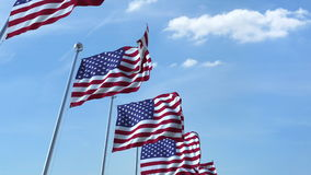 Row of waving flags of the United States agaist blue sky, 3D rendering Stock Images