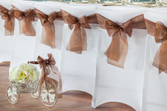 Row of wedding chairs with ribbons. Stock Image