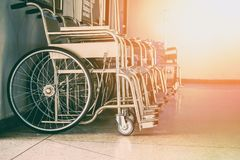 Row Wheelchairs in the hospital ,Wheelchairs waiting for patient services. Row Wheelchairs in the hospital ,Wheelchairs waiting for patient services Royalty Free Stock Photo