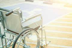 Wheelchairs in the hospital ,Wheelchairs waiting for disability person services. with light copy space on left area. Row Wheelchairs in the hospital ,Wheelchairs Royalty Free Stock Photography