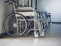 Row Wheelchairs in the hospital ,Wheelchairs waiting for patient services. Row Wheelchairs in the hospital ,Wheelchairs waiting for patient services Royalty Free Stock Photos