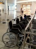 Row of wheelchairs. Wheelchairs waiting for disabled persons at Munich airport Stock Photos
