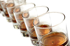 A row of  whisky glasses Royalty Free Stock Images