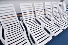 Row of white beach chairs Royalty Free Stock Photos