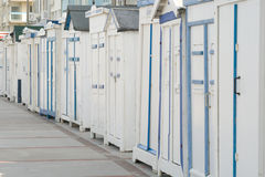 Row of white beach chalets Stock Photo