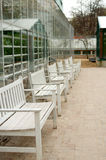 Row of white benches Royalty Free Stock Image